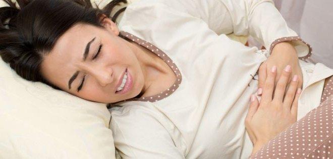calambres estomacales hinchados micción frecuente