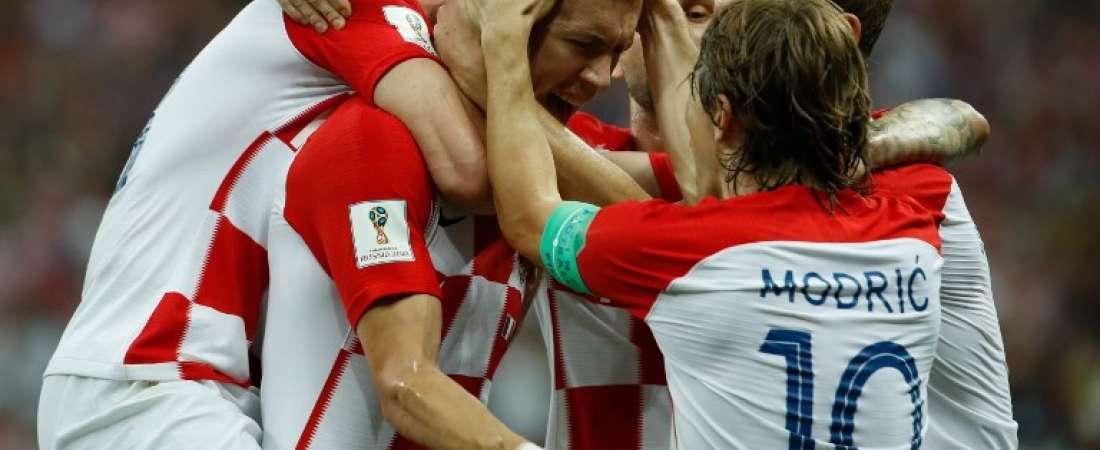 Jugadores croatas celebran el tanto de la igualdad. Foto: Odd ANDERSEN / AFP