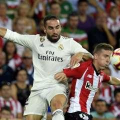 BILBAO, España.- Dani Carvajal (izquierda) trata de detener a Iker Muniain, autor del gol del Atlético. Foto: AFP