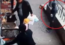 Se aprecia un hombre vestido de negro y con capucha, observando a la distancia al padre y su hija. Foto: Viral Tv
