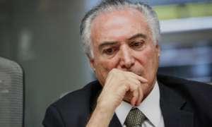Acusado por la fiscalía de obstrucción a la justicia, corrupción pasiva y organización criminal, muchas voces en Brasil piden su renuncia. Foto: Bloomberg