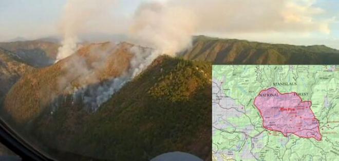 Un gran incendio fuera de control amenaza a más de 2.500 edificios.