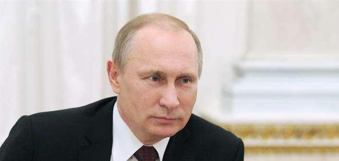 RUSIA.- El líder ruso no aparecía en público desde la entrevista con el primer ministro italiano Renzi. Fotos: EFE.