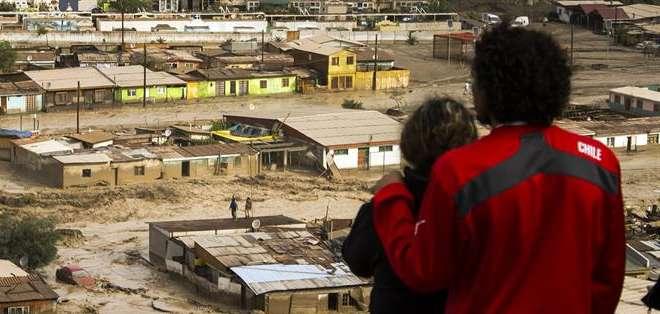CHILE.- Los damnificados sumaban unos 11.000 y el número de desaparecidos alcanzaba a las 20 personas. Fotos: EFE