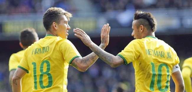 Firmino y Neymar en el partido ante Chile. Foto: EFE.
