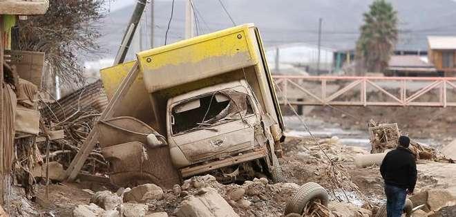 CHILE. Las lluvias y aluviones que arrasaron algunas poblaciones el pasado 25 de marzo destruyeron 2.071 viviendas y provocaron graves daños en otras 6.253 casas. Fotos: EFE