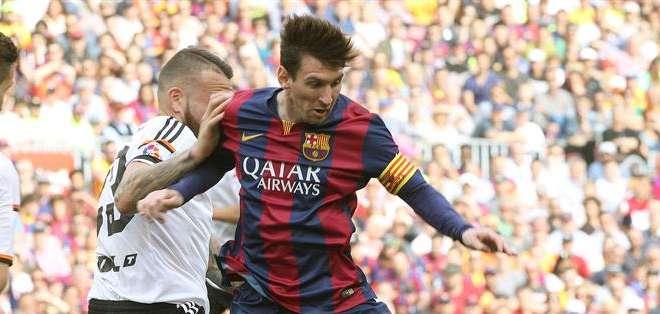 ESPAÑA.- El 'diez' del Barcelona demostró, de nuevo, que el Valencia es una de sus víctimas preferidas. Fotos: EFE