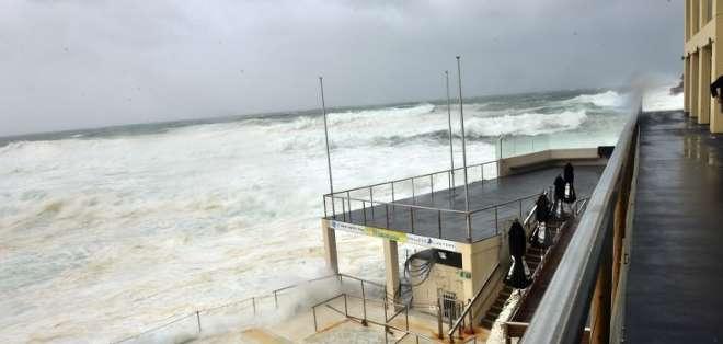 AUSTRALIA. Este martes, vientos de hasta 135 km/h y lluvias torrenciales golpeaban la región por segundo día consecutivo. Fotos: AFP