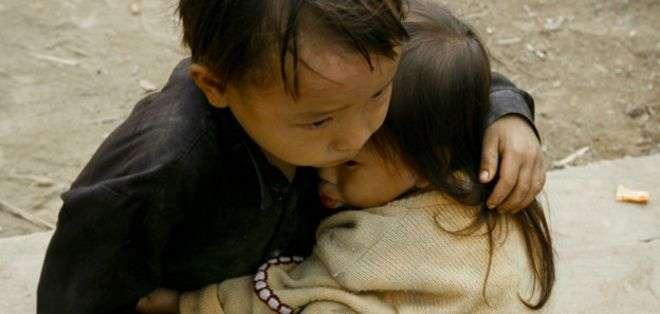"""La imagen captada por el fotógrafo vietnamita Na Son Nguyen también ha sido etiquetada en otros sitios como """"huérfanos birmanos"""" e incluso como """"víctimas de la guerra civil en Siria""""."""
