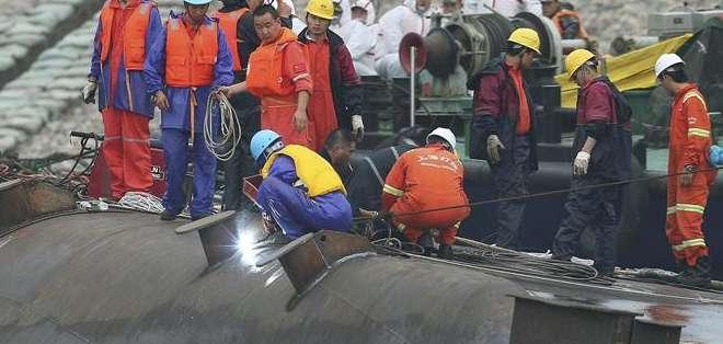 CHINA.- Al momento, se han recuperado 75 cadáveres y 14 supervivientes del lugar del naufragio. Fotos: EFE