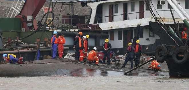 CHINA.- La cifra de cuerpos encontrados aumentó a los 77. Se tratará de un proceso difícil. Fotos: EFE