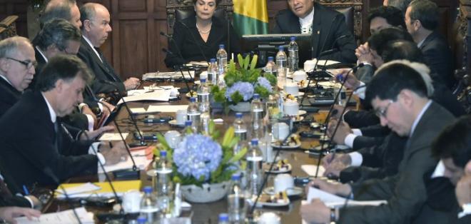 Ambos mandatarios acordaron resolver trabas al acceso de productos como el banano. Foto: AFP