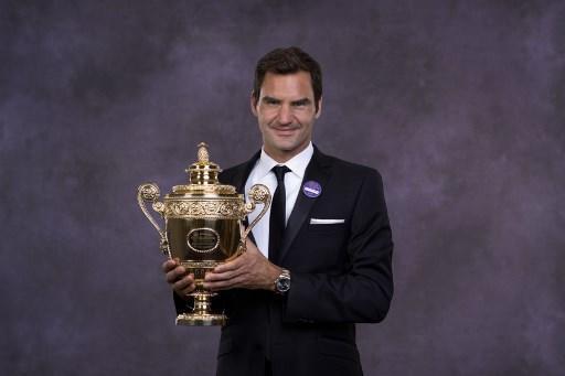 Roger Federer marcó un récord al llegar a ocho trofeos de Wimbledon. Foto: AFP