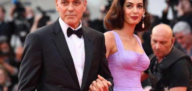"""""""En nombre de nuestros hijos Ella y Alexander, donaremos 500.000 dólares"""", dijo Clooney. Foto: AFP"""