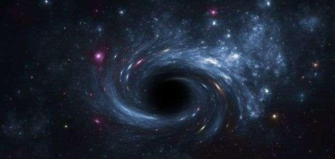 Recreación de un agujero negro rodeado de astros luminosos.