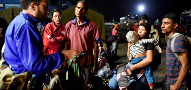 Atención a migrantes le cuesta a Ecuador $550 millones. Foto: AFP - Referencial