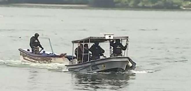 GUAYAS.- Dos personas fueron detenidas por miembros de la policía y el GIR. Foto: Captura de pantalla