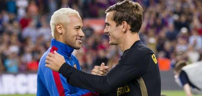 Neymar y Griezmann en un enfrentamiento en España.