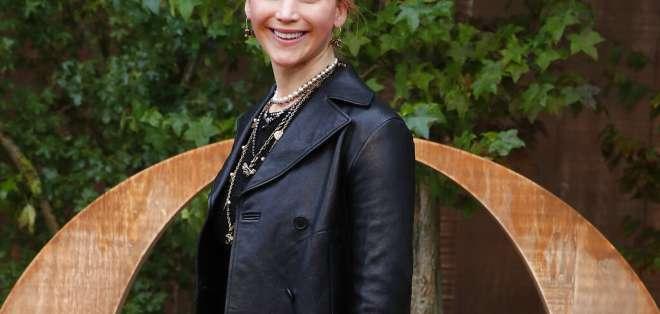 """La estrella de las películas """"Hunger Games"""" se casó con Cooke Maroney. Foto: AP"""