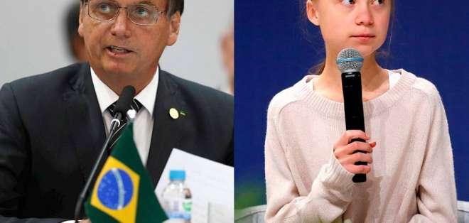 Jair Bolsonaro, presidente de Brasil y Greta Thunberg, joven activista sueca. Foto: EFE
