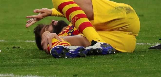 La lesión de Piqué se produjo en un ataque del Atlético. Foto: EFE