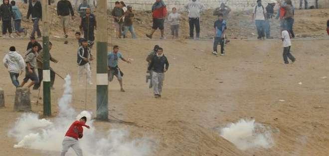 En Perú 1.500 policías desalojan a dos mil personas por ocupar terreno