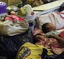 FILIPINAS. Hiyán forzó a unas 125.000 personas de 22 provincias filipinas a refugiarse en 109 centros de evacuación. Foto: EFE