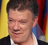 BOGOTÁ, Colombia.- El presidente de Colombia y candidato a la reelección, Juan Manuel Santos, celebra luego de que fuera reelegido. Foto: EFE.