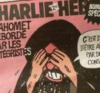 """Los miembros restantes de la redacción se han refugiado en las oficinas del diario """"Libération"""" para continuar con su trabajo, protegidos por un destacado despliegue policial. Foto: Archivo"""