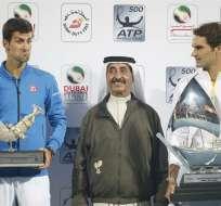 DUBÁI.- A sus 33 años, Federer suma el título 84 de su carrera y el segundo en 2015. Fotos: EFE