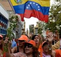 CARACAS, Venezuela.- Los miembros del partido de Leopoldo López aseguran que un militante murió tras enfrentamientos con chavistas. Foto AFP