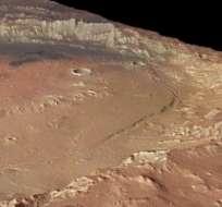 """Científicos explicaron que la posibilidad de que haya vida microbiana en el planeta rojo es """"muy grande"""" y que probablemente haya una capa de agua subterránea. Foto Nasa"""