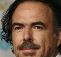 """Leoonardo Dicaprio (izquierda) protagoniza la película que triunfó en los Bafta, """"The Revenant"""", dirigida por el mexicano Alejandro González Iñárritu (derecha)."""