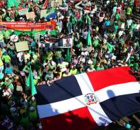 Miles de personas marcharon para exigir procesos judiciales contra funcionarios locales. Foto: EFE