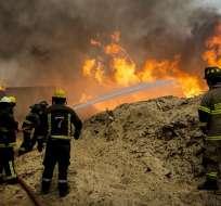 Aún hay más de 142 incendios activos, la emergencia ha dejado 10 fallecidos. Foto: AFP