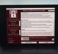 Una pantalla bloqueada por un ataque cibernético advierte que los archivos de datos se han cifrado. Foto: Tomado de El Nuevo Herald.