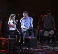 a artista colombiana y el líder de Coldplay se encargaron de la apertura del evento en Hamburgo. Foto: AFP