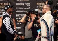 Mayweather (i.) y McGregor se enfrentará el próximo 26 de agosto. Foto: AFP