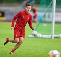 El brasileño Coutinho se presentó al entrenamiento con el Liverpool inglés.