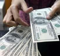 La dolarización se fortalece al no eliminarlo, según titular del BCE. Foto: Archivo / AFP