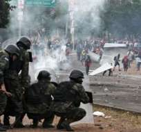 Ciudades como Tegucigalpa y San Pedro Sula fueron escenarios de escenas violentas. Foto: AFP.