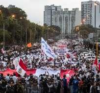 Partidarios del exgobernante marcharon por calles del centro de la capital. Foto: AFP
