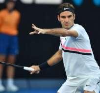 El suizo Roger Federer inicia con triunfo la defensa de su título en el primer Grand Slam de la temporada.