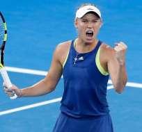 La danesa Caroline Wozniacki gana su primer Grand Slam en su tercer intento.