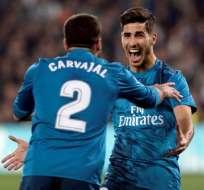 Marco Asensio (d.) anotó un doblete para el triunfo 'merengue'. Foto: AFP