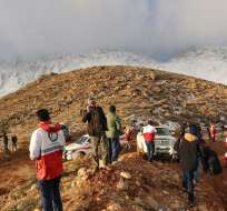 Debido a las inclemencias del clima, los rescatistas no podían acceder a la zona del incidente. Foto: AFP