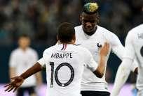 Kylian Mbappé (espaldas) anotó un doblete en el triunfo 'Galo'. Foto: AFP