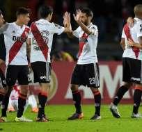 BOGOTÁ, Colombia.- El equipo de River Plate celebra tras su triunfo sobre Independiente de Santa Fe. Foto: AFP