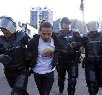 Policía los acusa de agredir a gendarmes en manifestaciones a favor de Rafael Correa. Foto: API