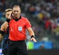 El árbitro argentino  dirigirá su cuarto partido en este mundial. Foto: Johannes EISELE / AFP